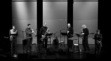 Readers Matthias Bossi (left) and Joan Mankin (right) with the ROVA Saxophone Quartet perform at OM 15