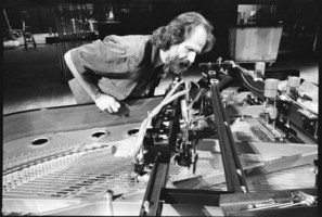 Trimpin examines a modified piano