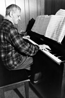 Leo Ornstein playing the piano in his living room