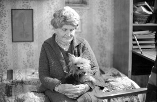 Germaine Tailleferre with dog, at her house in Paris
