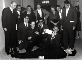 John Cage (laying down) and other composers at the Exposition Universelle et Internationale in Brussels