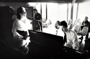 Pat Woodbury (left) sings as John Cage accompanies her on piano, Putah Creek Lodge