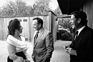 Pat Woodbury (left) talks with an unidentified man, as John Cage (right) looks on