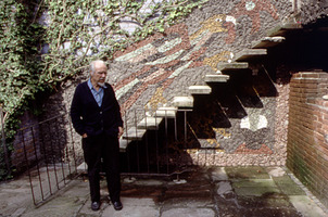 Conlon Nancarrow in front of mosaic by Juan O'Gorman, at this Mexico City home