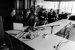 Michael Bach give a demonstration of his cello playing to Charles Amirkhanian (left) and other fellow OM 13 participants