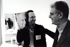 Mitchell Yawitz shows a picture of Dieter Schnebel to a smiling Charles Amirkhanian