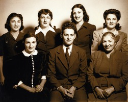 Benjamin Amirkhanian surrounded by his mother and sisters.