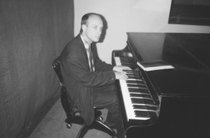 Brian Eno at the KPFA studio piano in February, 1988