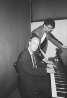 Charles Amirkhanian with Brian Eno at the piano in one of the KPFA studios