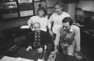 Brian Eno at the control board in the KPFA studio during Brian Eno Day, 1988. Engineers (r to l) Michael Yoshida, Jim Bennett, and Robin Gianattassio-Malle