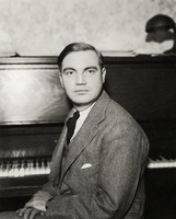 George Antheil seated at his piano