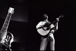 John Schneider playing the guitar during OM 14.