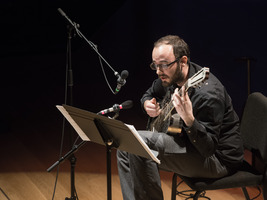 "Elliot Simpson performing excerpts from Larry Polansky's ""Songs and 'Toods"" during the second concert of OM 21"