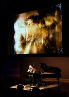 Kate Stenberg performing Michael Gordon's Light Is Calling(with video by Bill Morrison), during the second concert of OM 21