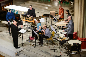 The William Winant Percussion Group performing Lou Harrison's Canticle No. 3 during OM 22. (l to r) Ben Paysen, Dennis Russell Davies (conducting), William Winant, Joanna Martin, Brian Baumbusch, Dan Kennedy, Nick Woodbury, Loren Mach.