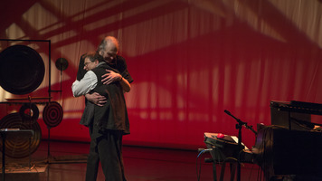 Lifelong pals Clark Coolidge and Alvin Curran hug after their performance on the first night of OM 23